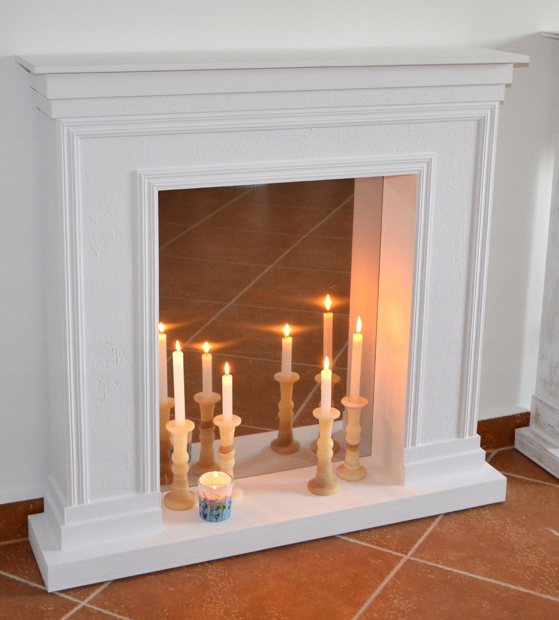 узкий длинный камин из свечей фото