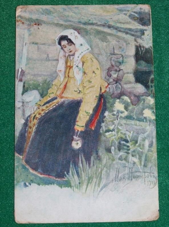 Siedząca kobieta - przedwojenna pocztówka