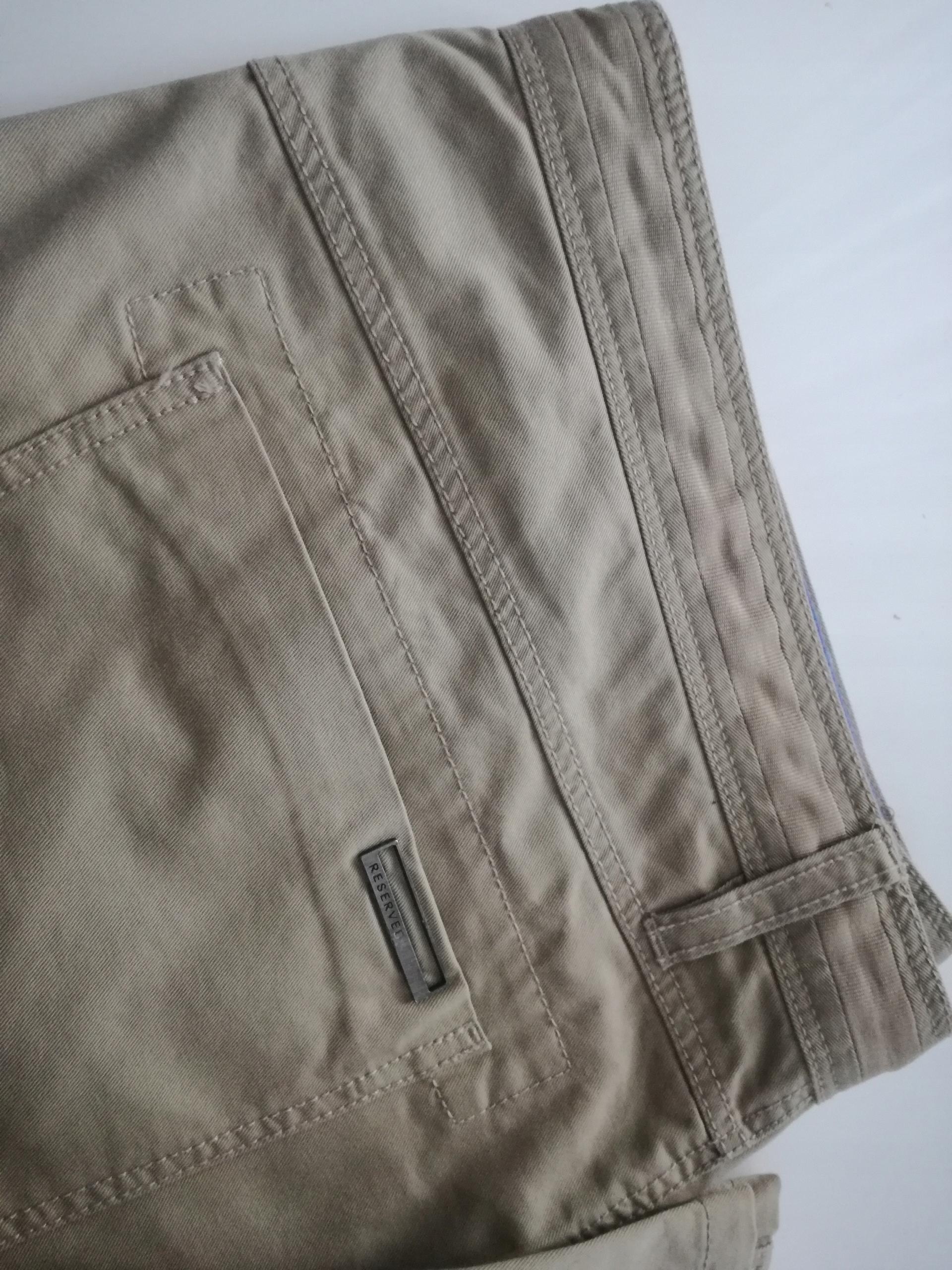 Spodnie męskie RESERVED beżowe slim fit rozm. 54
