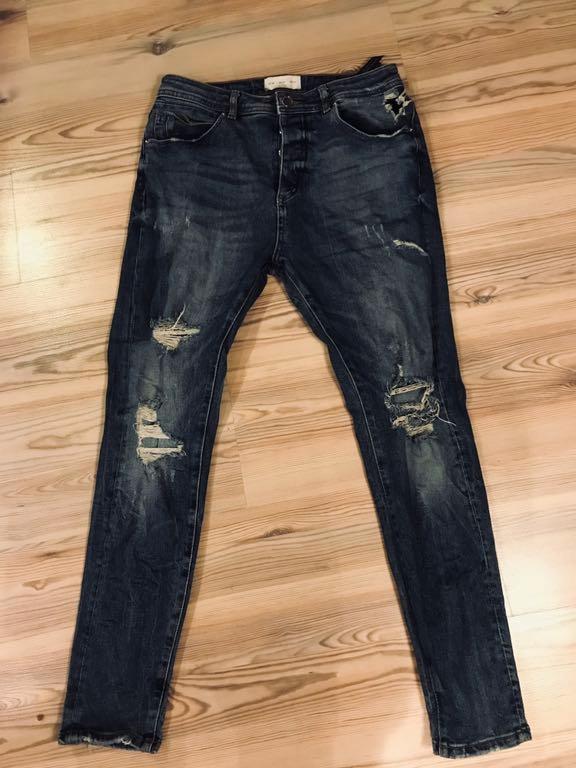 Zara men jeansy z przetarciami r.31