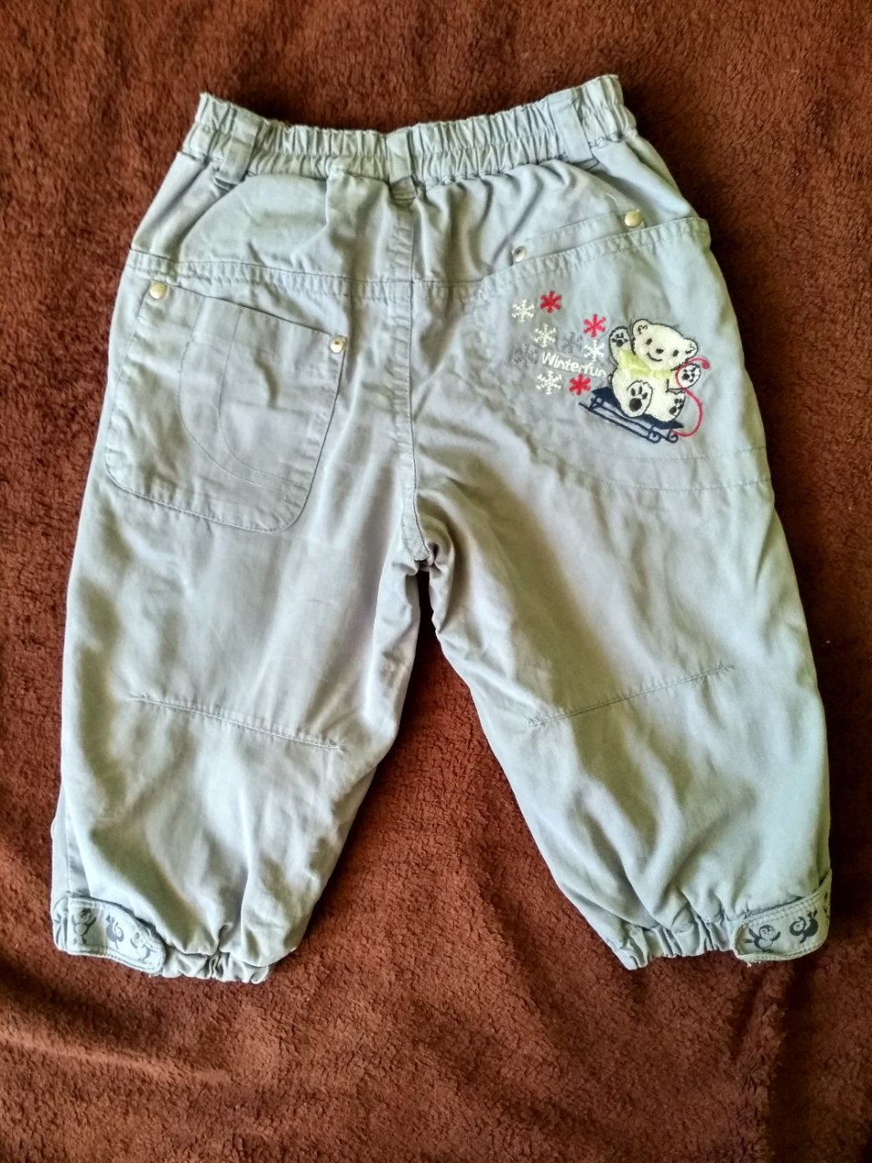 Spodnie materiałowe, lekko ocieplane - roz 80 HM
