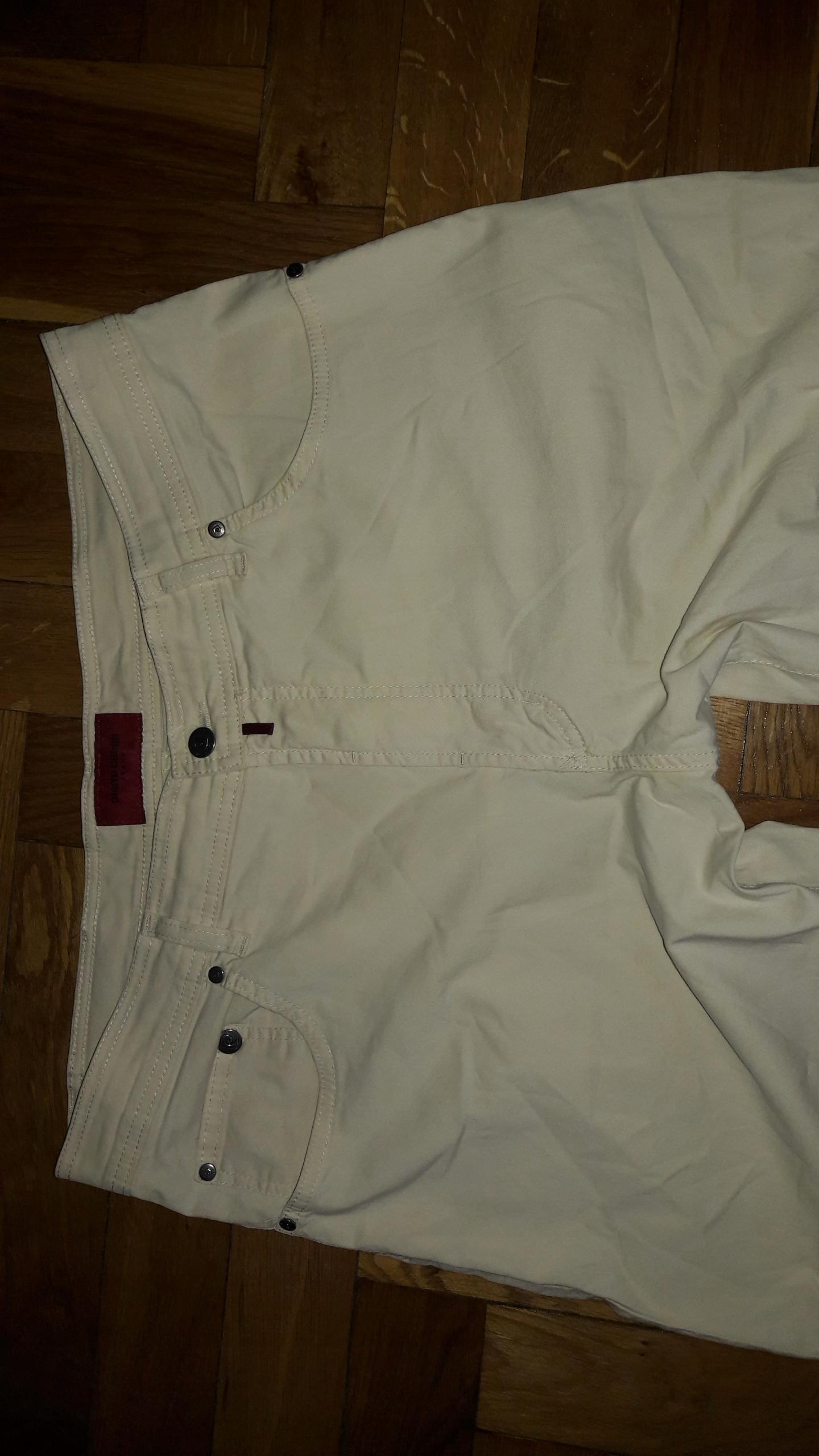Kremowe bawełniane spodnie Pierre Cardin W38L34