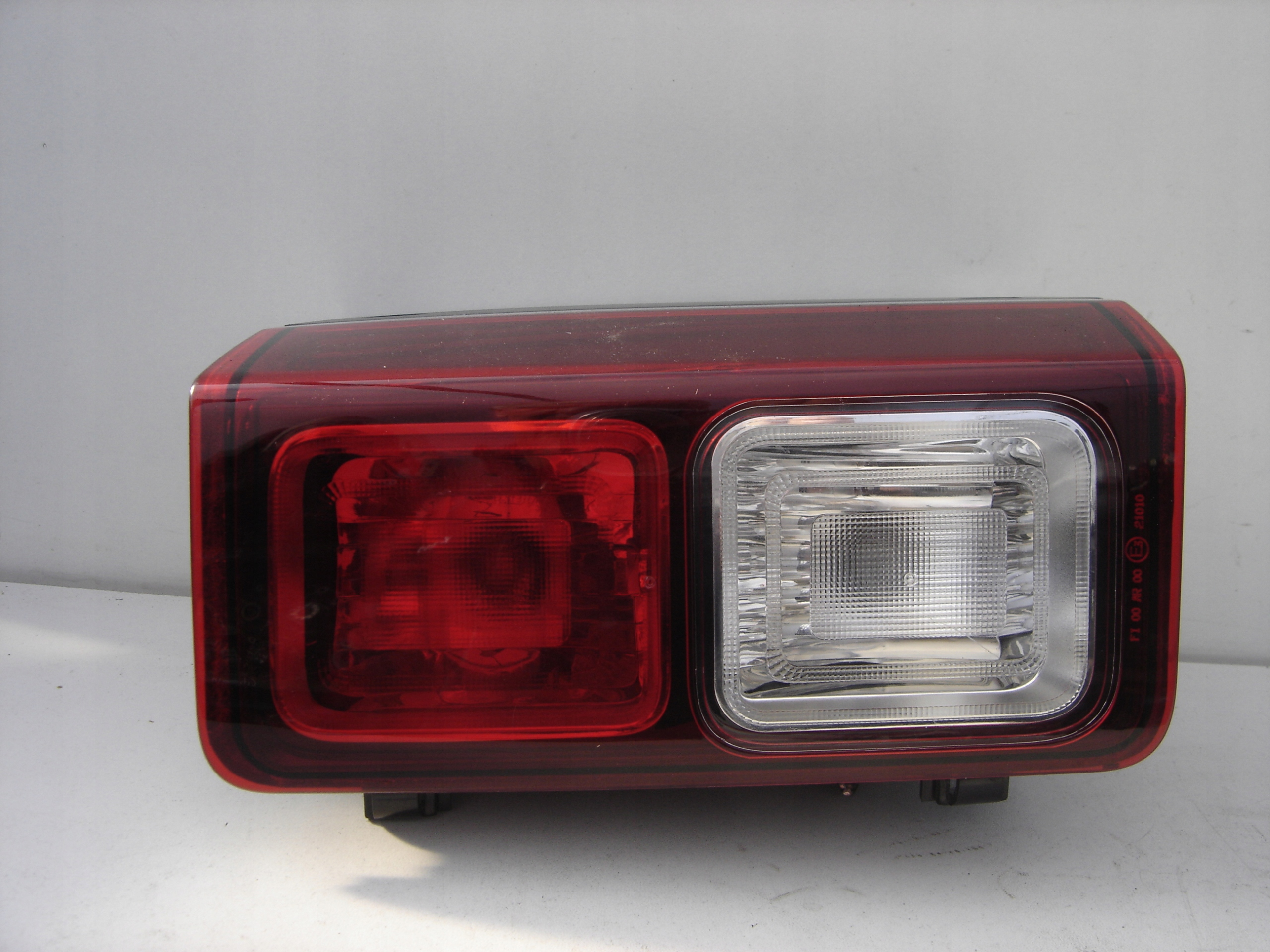 Lampa cofania Renault Trafic III 3 Lewa