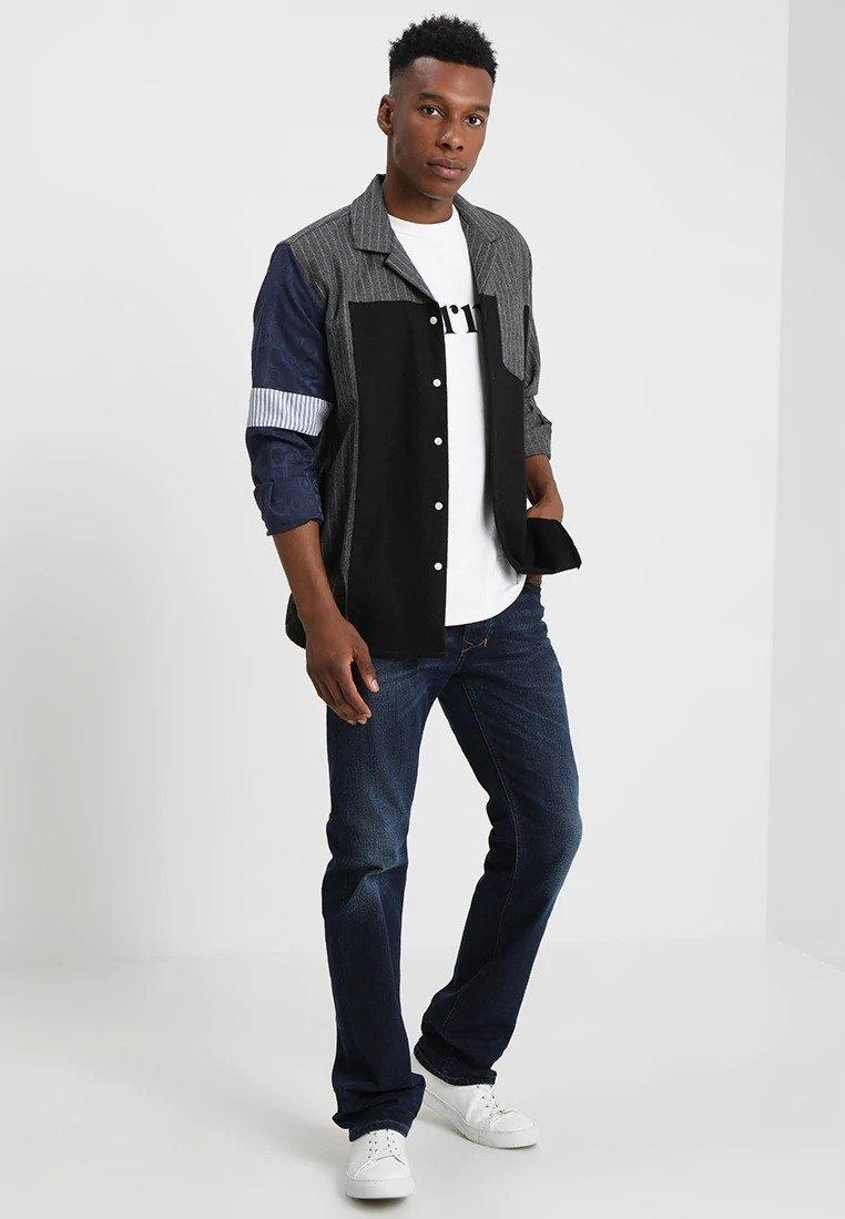 DIESEL Granatowe wycierane jeansy logo (W36L34)