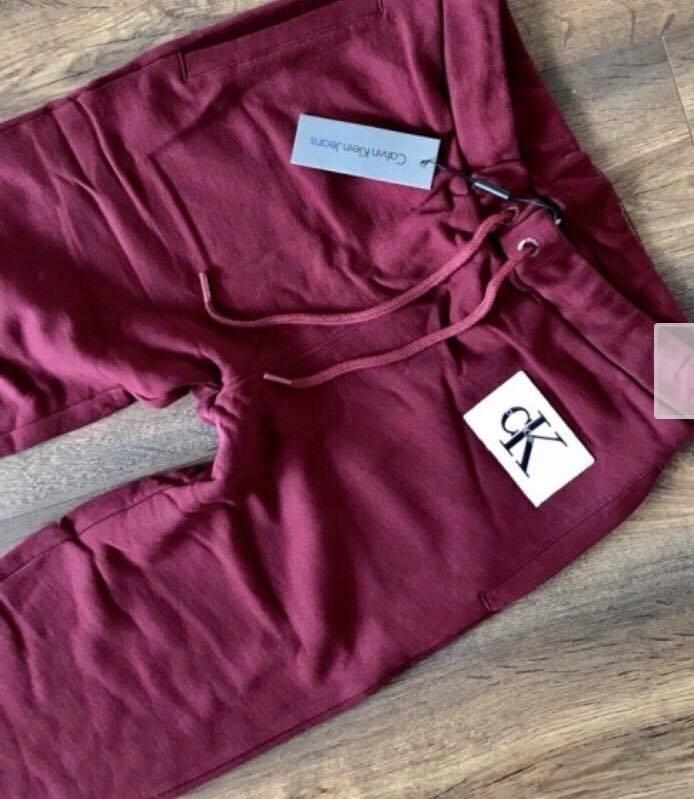 Calvin Klein Jeans Spodnie dresowe damskie BORDO M