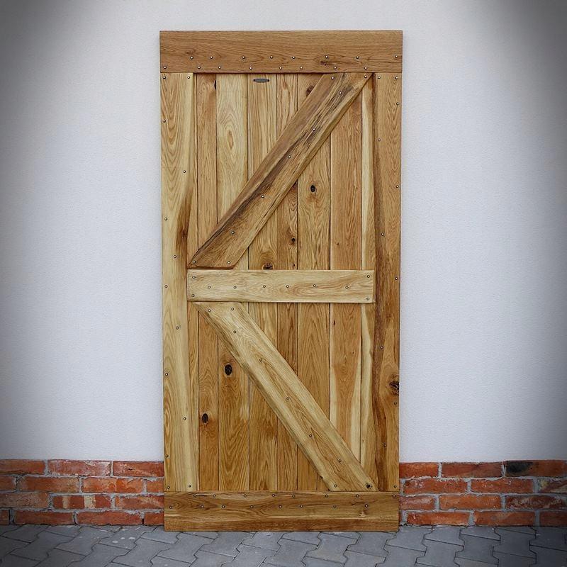 Retro posuvné dubové dvere FLINSTON s klincami