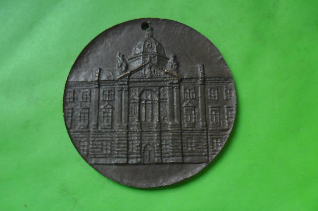 Fasada Akademii Ekonomicznej w Krakowie medal brąz
