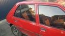 Peugeot 205 5 двери правый зад треугольник brazowa