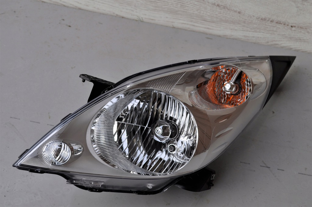 Lampa Lew CHEVROLET SPARK M300 12-15 ORYGINAL NOWA