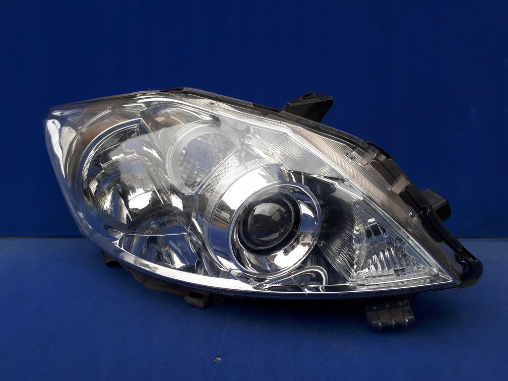 TOYOTA AURIS I LIFT 2010-2012 10- REFLEKTOR LAMPA