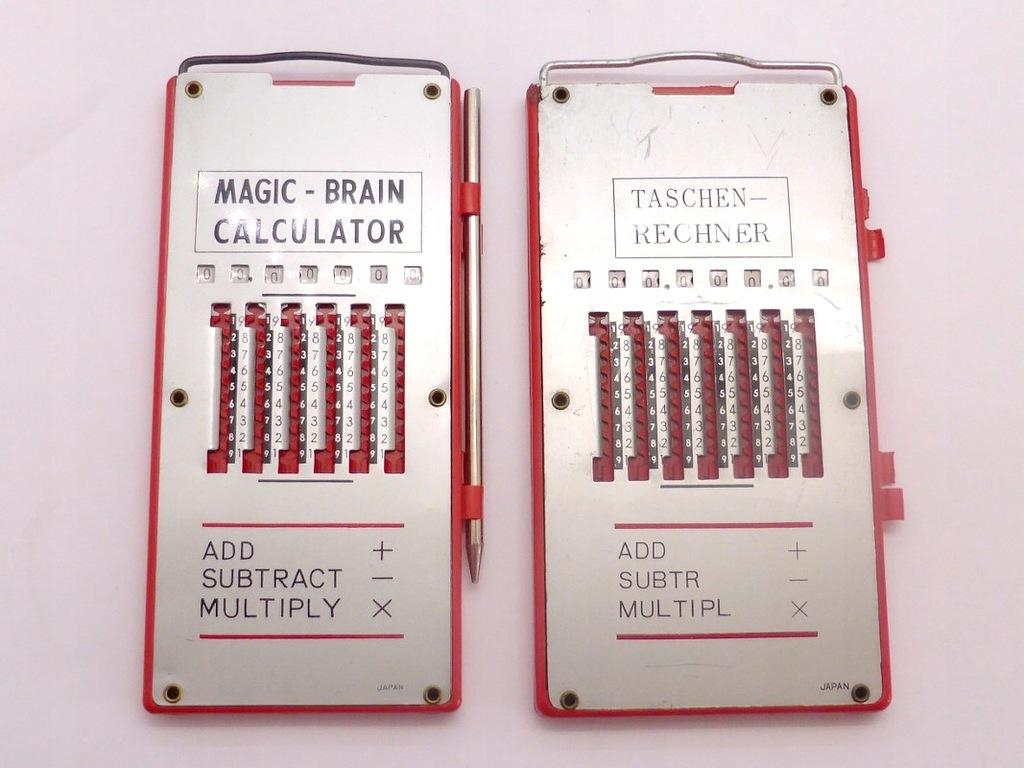 2 stare kalkulatory.