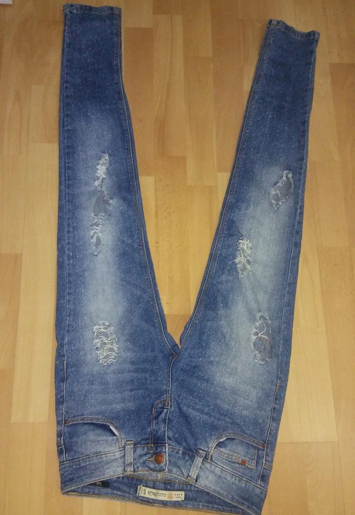 jeansy damskie RURKI z dziurami i przeytarciami