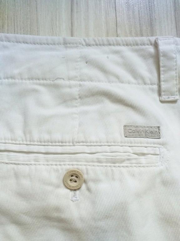 Białe spodnie męskie sztruksy CALVIN KLEIN_34/32