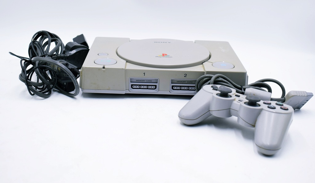5912-9 ...SONY PLAYSTATION ONE... a#g KONSOLA PAD