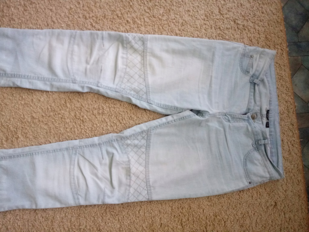 Damskie jeansy light blue rozm.42