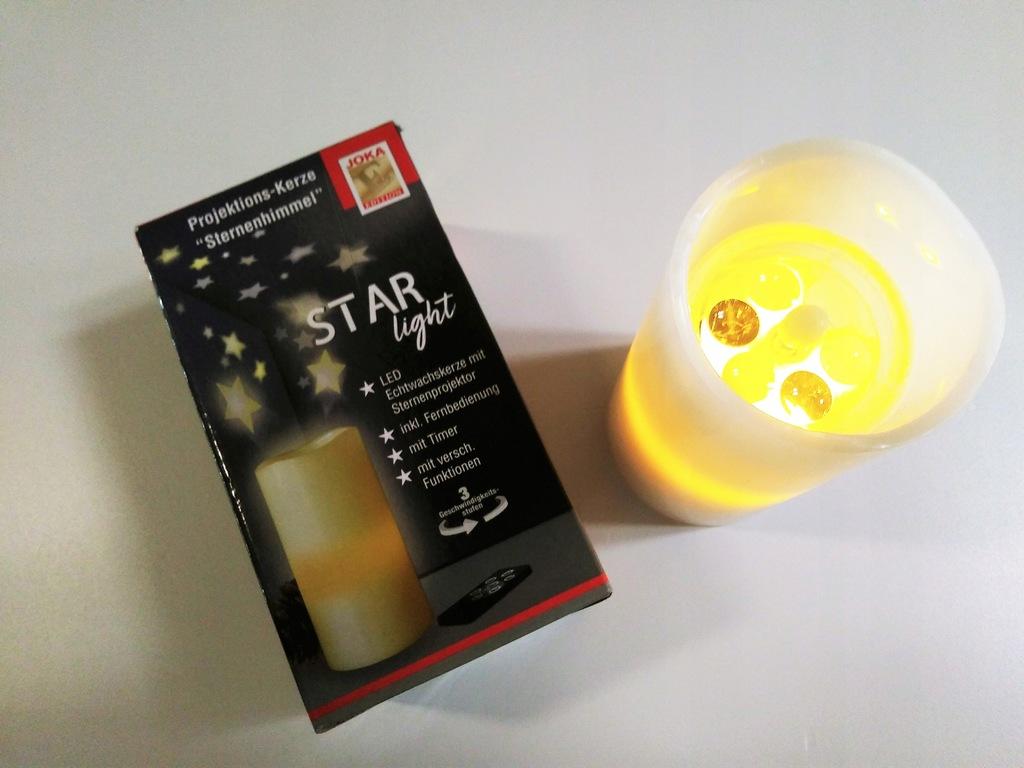 Lampka nocna imitacja świeczki projektor gwiazdy.