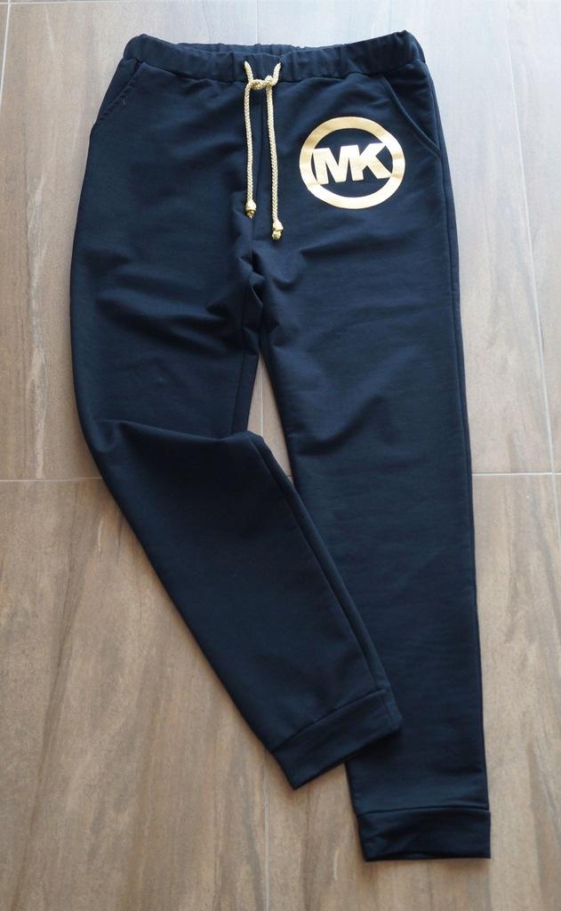 Czarne spodnie ze złotym MK roz.wypada na M