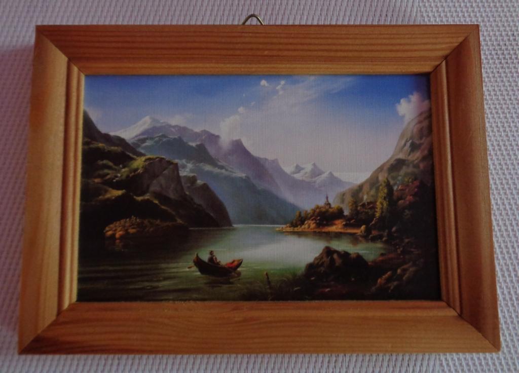 Mały obrazek w drewnianej ramce
