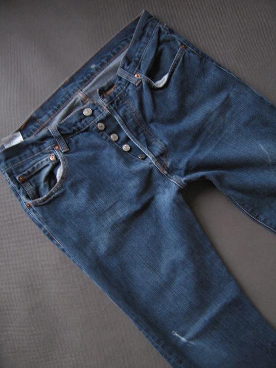 Kultowe spodnie męskie jeansy Levi's 501 W34L32