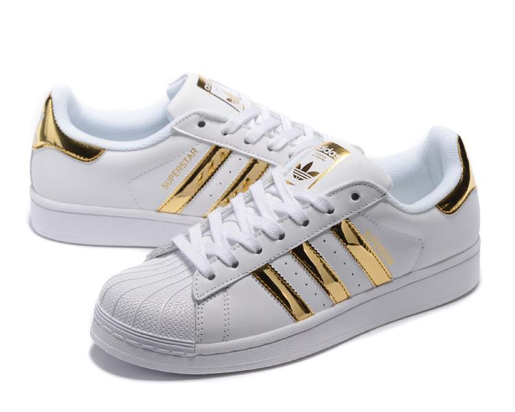Buty adidas ze złotymi paskami Oryginalne