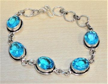 bransoletka z swiss blue topazami 56.60ct