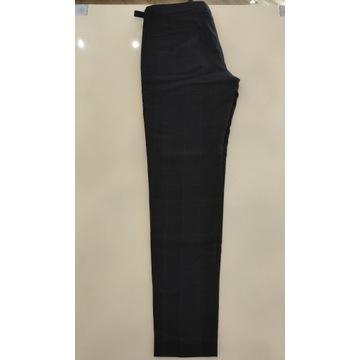 Wełniane ciemnoniebieskie spodnie Mango roz. 44