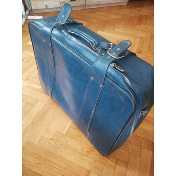 Duża solidna skórzana walizka na suwak i klamry