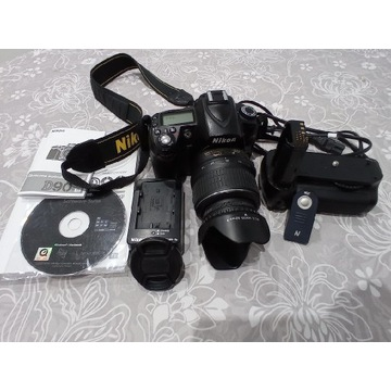 Nikon d90 + N18-55vr + grip + pilot,  stan bdb