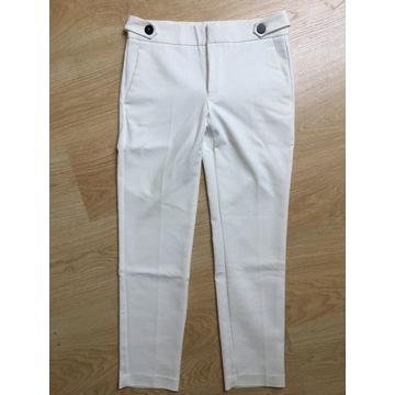 Białe eleganckie spodnie Mango