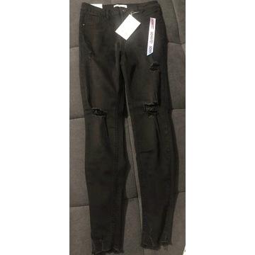 Spodnie jeans dziury przeetarcia L