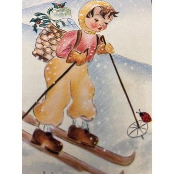 Pocztówka z narciarzem oraz biedronką