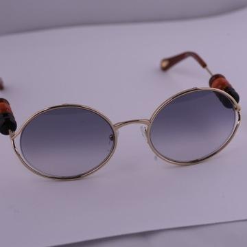 Okulary przeciwsłoneczne Galanteria i dodatki Strona 26