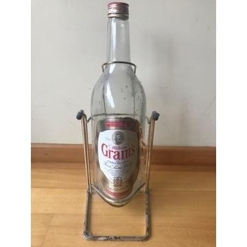 Butelka 3L Po Grant's whisky na stojaku bitcoin