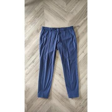 Niebieskie spodnie garniturowe Recman roz. M