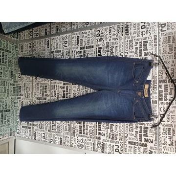 Spodnie jeansowe damskie marki Wrangler