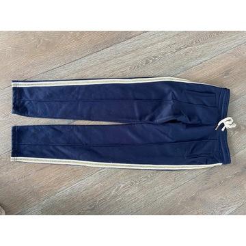 Femi Stories  xs granatowe spodnie dresy