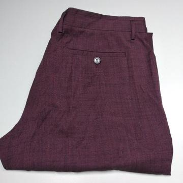 Lekkie, piękne spodnie Vivienne Westwood rozm. 56