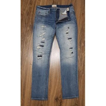 męskie jeansy GAP 32/32 z łatami błękitne jasne