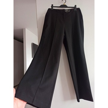 Nowe z metkami eleganckie szerokie spodnie 42 XL