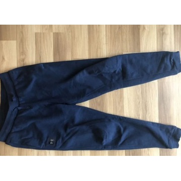 Spodnie dresowe under armour M