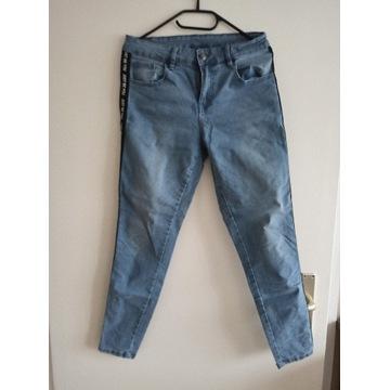 Spodnie jeansy damskie r. 36/38