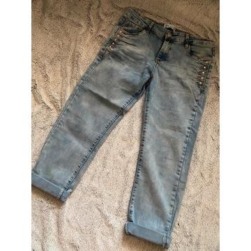 Niebieskie spodnie jeans dżinsowe