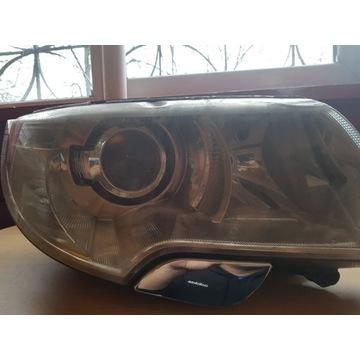 Reflektor xenon prawy,skoda superb II 2009r.