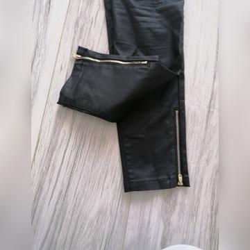 Woskowane czarne spodnie rozm 38