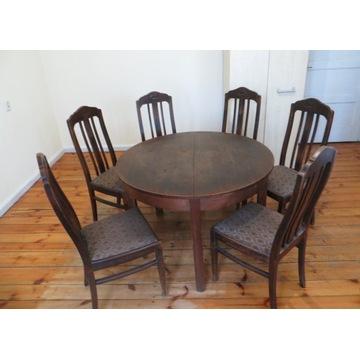 Stół okrągły, rozkładany z kompletem krzeseł.