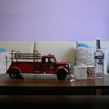 Stojak na a.l.k.o.h.o.l wóz strażacki