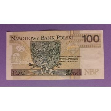Banknot 100zł seria DH 9555565
