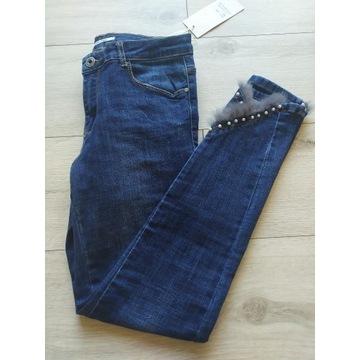 Spodnie dżinsowe skinny ozdobne nogawki
