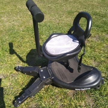 Dostawka do wózka z siedziskiem