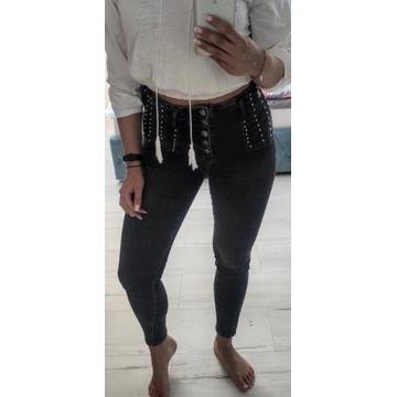 Spodnie dżinsowe cyrkonie ćwieki wysoki stan M 38
